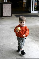 exiting the neighborhood grocery store with his chosen snack, a banana - _MG_0256
