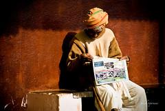 .Democracy.?. (.krish.Tipirneni.) Tags: people orange news man bench paper democracy sweater education dhoti currentaffairs literacy rktpeople peopleold arugu earlymorningm
