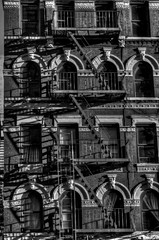 NYC (NathanSlabaughPhotogrpahy/CircusCoffee) Tags: old nyc windows shadow bw building brick architecture vintage evening apartments arch afternoon fireescape symetry stoop hdr highdynamicrange walkup newyorkcty 4story