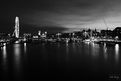 Almost Dark (mono) (Mo Baig) Tags: city longexposure travel sunset blackandwhite bw copyright reflection london thames reflections mono nikon view housesofparliament londoneye parliament riverthames allrightsreserved nikond40x d40x sigma18200mmoshsm touraroundtheworld mobaig