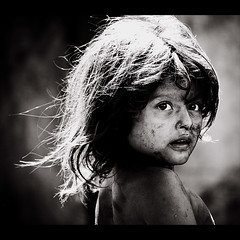 Girl of the garbage dump (gunnisal) Tags: world street city portrait people bw girl child faces candid young expressive nicaragua managua theface 500x500 blueribbonwinner olympuse500 fivestarsgallery mywinners abigfave abigfive lachureca artlibres winner500 favekids