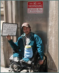 can you please help me with my walking prosthetics (TheeErin) Tags: usa chicago man hat sign person illinois thankyou unitedstates baseball candid wheelchair baseballhat il pylon help stump irony veteran northeast amputee notresspassing violators godbless chicagoist prosthetics michiganavenuebridge northeastpylon