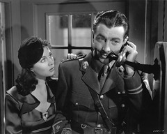 "Vivien Leigh  & Robert Taylor in ""Waterloo bridge"" (Silver Screen Sirens) Tags: cinema vintage movie uniform antique telephone 1940s actress actor beret silverscreen waterloobridge vivienleigh roberttaylor"