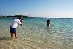 hoping for a great shot!!!!!!!!!!!!!!!! (picash) Tags: camera sea hot sexy beach water girl beautiful hat nikon paradise dominicanrepublic bikini paparazzi swimsuit magicmoments hansom esotic goldstaraward