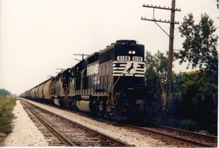 Southbound Norfolk Southern transfer train traveling over the Belt Railway of Chicago tracks at West 63rd Street. Chicago Illinois. August 1988.
