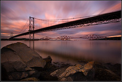 Forth Bridges (Ally Mac) Tags: road uk longexposure bridge sunset sea canon scotland edinburgh suspension structures bridges scottish rail forth both 1022 firth firthofforth forthrailbridge warer cloudmovement nd1000 40d nd110