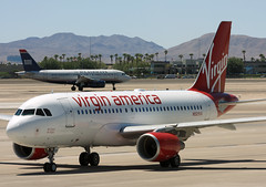 Let There Be Flight (A Sutanto) Tags: red usa america us airport lasvegas nevada nv airbus airlines lv mccarran a320 usairways vx a319 virginamerica n521va