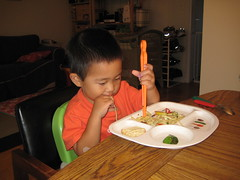 Eating pasta with chopsticks