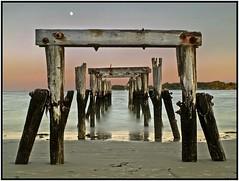 TWILIGHT PIER (Camerist Obscured) Tags: ocean moon water pier twilight sand massachusetts northshore beverly pilings beverlyfarms westbeach blueribbonwinner olympuse500 flickrsbest diamondclassphotographer goldstaraward qualitypixels globalworldawards oldnikkor28mmf28