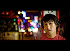 Wilson (TGKW) Tags: boy portrait people signs bus night lights waiting neon bokeh chinese hong kong stop wilson nightlife mongkok