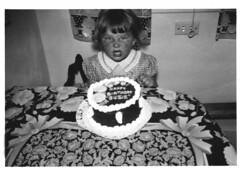 My Mother turns 2 (Zombie Normal) Tags: birthday blackandwhite cake mother birthdaycake 1950s tablecloth sourpuss 1950 1951 grumpyface angryface checkeddress