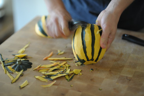 Use a vegetable peeler to remove the squash's flesh along the exposed ribs.