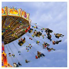 Circus Swing, Munich, Germany (Grufnik) Tags: blue sky people cloud color fling germany munich münchen fun deutschland amusement force ride bright circus spin leg oktoberfest swing ornate midway 2008 dangle centrifugal 175th
