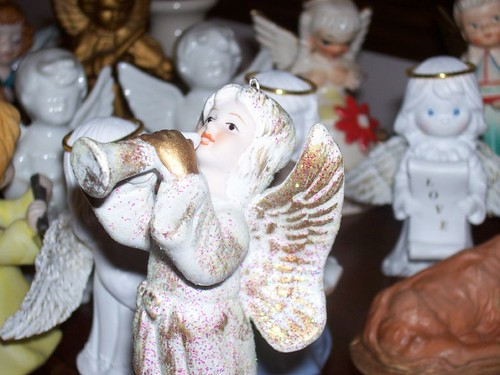 White and gold angel with trumpet