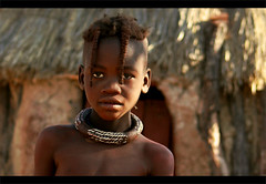 Young Himba portrait - Namibia (kryyslee) Tags: world voyage africa travel boy portrait color colors face canon photography eos photo kid gesicht foto child faces photos couleurs african young picture culture tribal du safari afrika around tribe christophe monde ethnic 2008 backpacker enfant pict namibia autour couleur tribo visage himba afrique ethnology tribu jeune garcon namibie visages 50d tribus ethnie 400d himbas kryyslee christophepaquignon paquignon