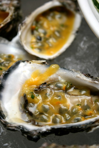 Oysters on ice with passion fruit