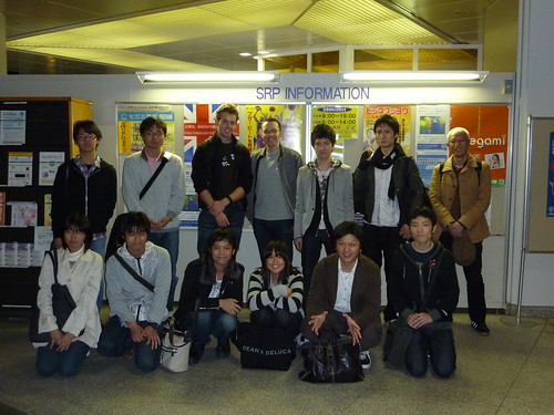 [Speakers and organizers of the event posing for a picture together.]