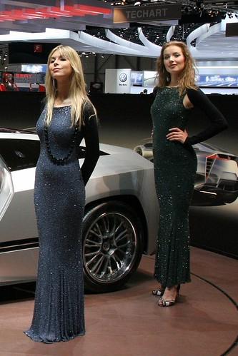 Two strong models in black dresses on Geneva Motorshow