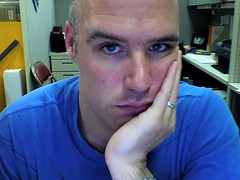 So incredibly bored. (aronoff) Tags: work bored depressed bleh blueshirt