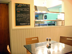 Specials board and kitchen at The Tailend Fish Restaurant and Fish Bar, Edinburgh