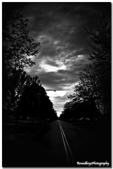 Down the Road B&W (RoundboyzPhotography) Tags: road bw clouds converginglines