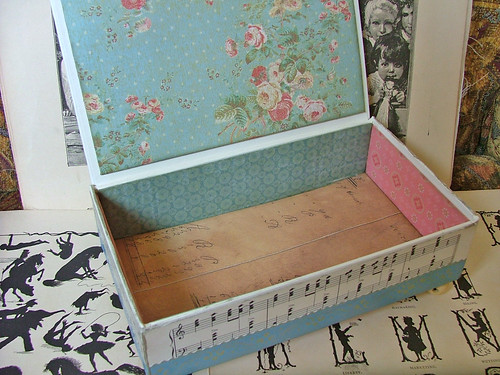 blue and pink box covered with vintage paper