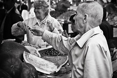 Buying vegetables (Conny Lundgren) Tags: bw delete10 delete9 delete5 50mm prime delete2 skne sweden delete6 delete7 schweden streetphotography save3 delete8 delete3 delete delete4 save save2 save4 5d sverige malm sucia malmo suecia scania resund sude resund svezia ruotsi canoneos5d mllevngstorget isve 50l  canonef50mmf12lusm scandinaviabw canon5dclassic