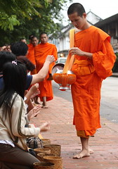 collecting alms (detengase) Tags: orange colour feet colors canon foot eos asia asien southeastasia prayer religion culture monk buddhism unesco monks barefoot tradition laos luangprabang offerings alms moine louangphrabang novices northernlaos theravadabuddhism
