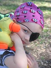 The parrot on her shoulder