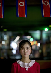 National day in North Korea (Eric Lafforgue) Tags: pictures travel woman cute girl beauty asian restaurant photo women war asia serious flag picture korea kimjongil asie waitress coree fille journalist journalists northkorea drapeau  dprk coreadelnorte beaute serveuse juche kimilsung nordkorea lafforgue  ericlafforgue   coredunord coreadelnord  northcorea coreedunord rdpc  insidenorthkorea  rpdc   coriadonorte  wiatress kimjongun coreiadonorte  dprk0671