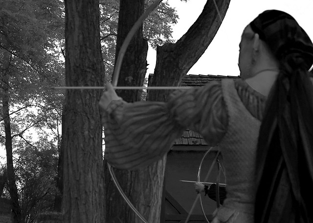 S. shooting a bow and arrow at the renaissance festival