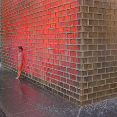 Red Fountain (robert schneider (rolopix)) Tags: red sculpture white chicago color film water girl yellow wall 35mm square grey glow fuji august 200 ddr fujifilm zeissikon millenniumpark 2008 crownfountain gdr riteaid taxona cheapfilm tessar eastgerman 24x24 housebrand redfountain fixedshadows believeinfilm