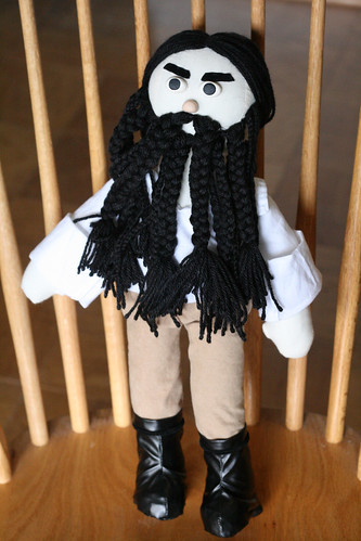 Beard, hair, mustache, eyes, nose, and eyebrows are all sewn securely onto him.   At the urging of concerned friends, I also made him pants. Which wont matter, because his overcoat will cover them up.