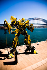 Postcards from Earth (Steve Koukoulas) Tags: travel bridge shadow summer vacation holiday water yellow photoshop reflections pose movie toy bay tv transformer harbour earth postcard ss cartoon sydney australia camaro bumblebee galaxy 80s fist faux layers therocks operahouse merge autobot wishyouwerehere blend tiltshift exlpore michaelbay canonef24105mmf4lisusm