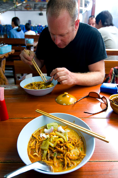 Andy Ricker, chef/owner of Pok Pok, in Portland, Oregon, eating khao soi at Samoe Jai Fah Ham, Chiang Mai