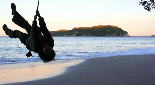 rope swing at sunset