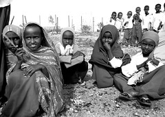in the schoolyard (LindsayStark) Tags: africa travel school blackandwhite girl kids children war child refugee hijab conflict somali ethiopia schoolkids humanrights humanitarian somalia displaced refugeecamp humanitarianaid emergencyrelief postconflict waraffected conflictaffected jijiga