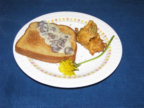 Chicken heart gravy on toast with friend dandelion blossoms.