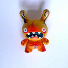 Terry the Fire Demon 3 (squink!) Tags: red urban orange cute monster toy toys fire gold weird scary handmade painted teeth vinyl kidrobot demon toothy custom dunny customised squink