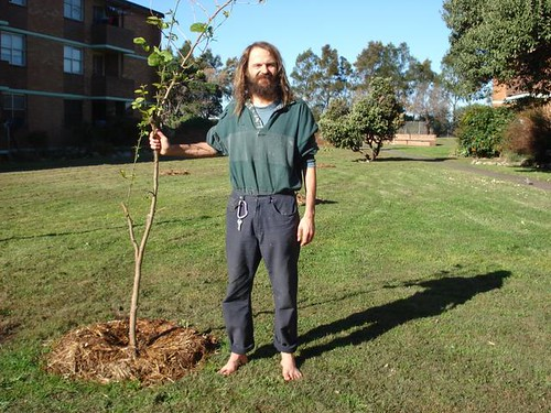 Me, yesterday, standing next to a recently planted fruit tree..
