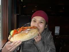 Julia eating giant Roast Beef Baguette - Pub Bistro, Thredbo