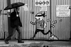 Unexpected meeting - 20081129_0034edcr (greekadman) Tags: street bw streetart man art walking greek graffiti grafiti interestingness1 meeting athens greece stickup interaction decisivemoment coupole interestingness2 canon30d interestingness17 i500 canon24105f4 explore291108