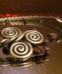 My Thoughts Swirl and Become Reflective (JackieG...) Tags: red brown macro reflection tag3 taggedout spiral mirror necklace tag2 tag1 selftaught utata sliver torque coffeebeans torc utata:project=ip85