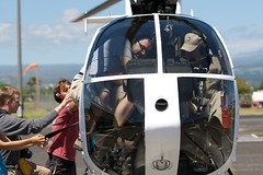 It took a team of helpers to get Cal into the helicopter! (Tom Coates) Tags: paulhammond helicopter calhenderson tightsqueeze hiloairport flickr:user=bees