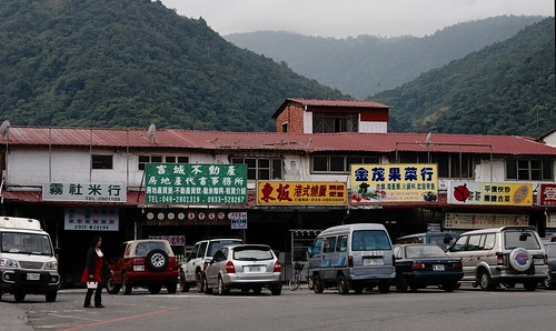 Looking behind this row of mundane shops you can get a sense of the surrounding landscape.
