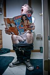 Taking a dump. (Aaron Van Dike | www.aaronvandike.com |) Tags: canon bathroom cosmopolitan aaron pooping ultrasonic canon1740l canon30d strobist boomstand aaronvandike ughtohnotoiletpaper aaronvandikedropsthecosbykidsoffatthepool