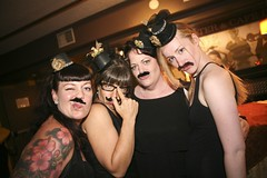 Hot bridesmaids… with mustaches.