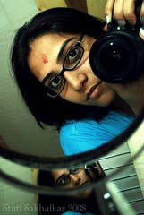 Day 5 : Focussing on the focussed ! (Stuti ~) Tags: blue red girl lady canon reflections project glasses mirror photo day shaving 365 forehead spectacles vermillion 400d