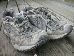 Retired. (Invincible One) Tags: shoes running sneakers goodbye dirtyshoes runningshoes wornsneakers beatupshoes favoritepairofrunningshoes