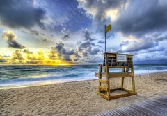 Alone at the Beach (Stuck in Customs) Tags: ocean life wood travel sunset panorama storm motion feet beach water colors beautiful lines weather composition sunrise wonderful photography amazing intense boards sand nikon surf shoot waves photographer shot angle image florida unique background details guard d2x perspective picture lifeguard adventure edge processing pro lonely breakers framing top100 portfolio lovely beath capture emotions palmbeach hdr tutorial mixture masterpiece 2007 treatment thebreakers travelphotography thewinterofmydiscontent d2xs hdrtutorial stuckincustoms treyratcliff